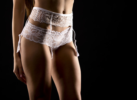 sexy woman wearing white lingerie on black background