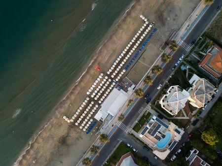 Photo pour Top view of a coastal town with a beach and beach umbrellas. Terracina, Province of Latina, Lazio Region, Italy - image libre de droit