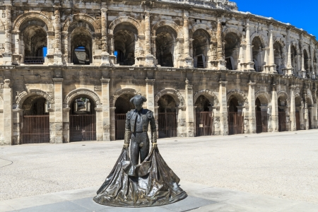 Statue of matador Nime II in front of Roman Amphitheater in Nimes, France