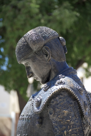 Statue of matador Nimeño II in front of Roman Amphitheater in Nimes, France