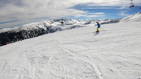 Photo pour Skiing, winter, ski vacation - young boy skiing down, fun on mountainside - image libre de droit