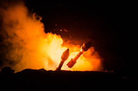 Rocket launch with fire clouds. Nuclear Missiles With Warhead Aimed at Gloomy Sky at night. Balistic Rockets War Backgound.
