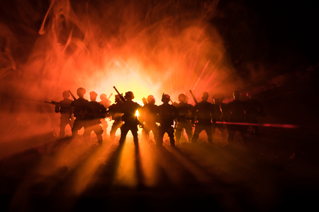 Photo pour Anti-riot police give signal to be ready. Government power concept. Police in action. Smoke on a dark background with lights. Blue red flashing sirens. Dictatorship power. Selective focus - image libre de droit