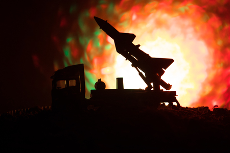 Rocket launch with fire clouds. Battle scene with rocket Missiles with Warhead Aimed at Gloomy Sky at night. Rocket vehicle on War Backgound. Selective focus