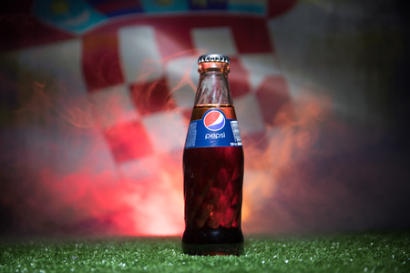 BAKU,AZERBAIJAN - JULY 01, 2018 : Creative concept. Pepsi Classic in a glass bottle on grass. Support your country in World cup 2018. Selective focus