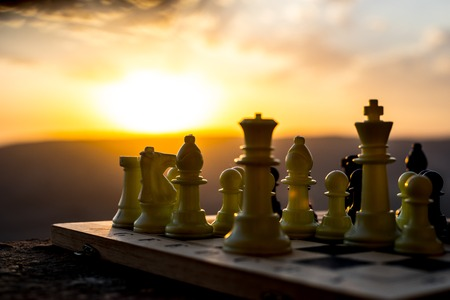Photo pour chess board game concept of business ideas and competition and strategy ideas. Chess figures on a chessboard outdoor sunset background. Selective focus - image libre de droit