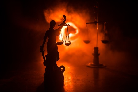 Photo pour The Statue of Justice - lady justice or Iustitia / Justitia the Roman goddess of Justice on a dark fire background. Selective focus - image libre de droit