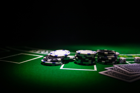 Photo pour Cards and chips on green felt casino table. Abstract background with copy space. Gambling, poker, casino and cards games theme. Casino elements on green. Selective focus - image libre de droit