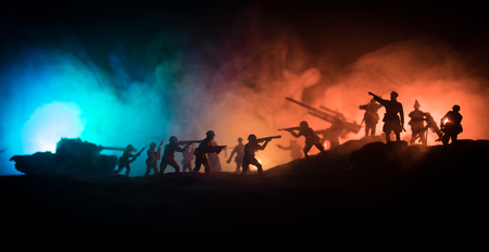 Photo for War Concept. Military silhouettes fighting scene on war fog sky background, World War Soldiers Silhouette Below Cloudy Skyline At night. - Royalty Free Image