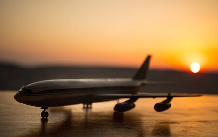 Photo for Artwork decoration. White passenger plane ready to taking off from airport runway. Silhouette of Aircraft during sunset time. Selective focus - Royalty Free Image