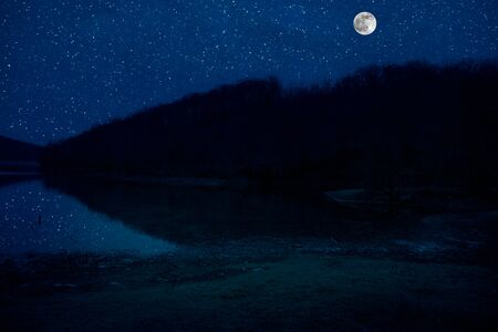 Photo for Landscape of gorgeous full moon over the snow-capped mountains reflected in the lake or mysterious night sky with full moon - Royalty Free Image