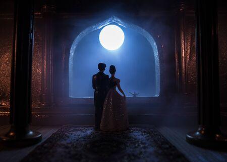 Photo pour Beautiful arabian interior realistic miniature. Table decoration. Romantic couple at window. Selective focus - image libre de droit