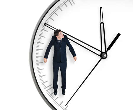 Businessman hangs on an arrow of clock, isolated on white background