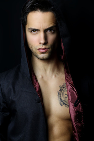 handsome mysterious man with a tattoo