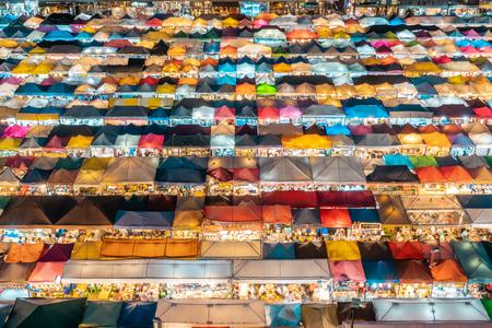 BANGKOK, THAILAND - AUGUST 12, 2018: Closeup aerial shot of market stalls in the famous Train Market in Bangkok