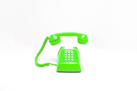 Foto de Green classic telephone on white background, phone ringing, phone floating in the air, waiting someone to receive phone call. - Imagen libre de derechos