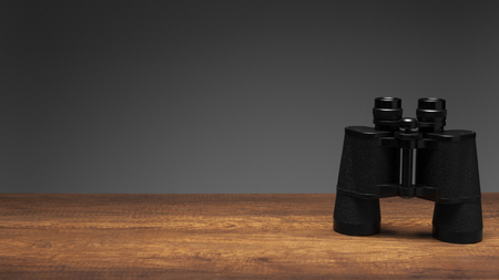 Photo for Vintage black binoculars on wood table and gray background with texting space, travelling concept. - Royalty Free Image