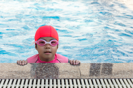 Photo for young girl swimming in pool. - Royalty Free Image