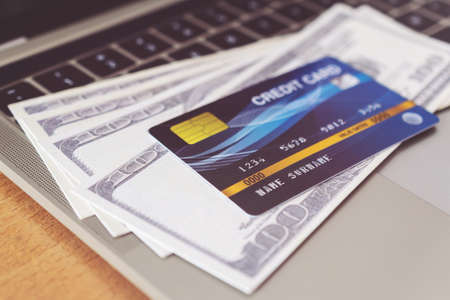 Photo pour Credit card and money on a computer keyboard. shopping online concept, Online payment - image libre de droit