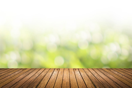 Photo pour Brown grunge wooden floor with abstract blurred background in light green nature tone color. use for backdrop or web design in environment concept. - image libre de droit