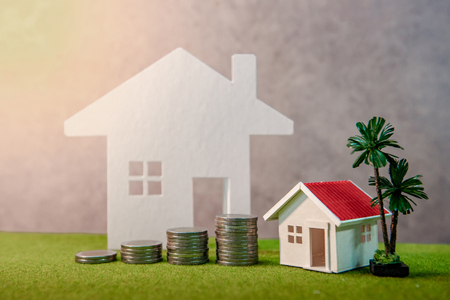 Photo pour Real estate investment or Home mortgage loan rate. Property ladder concept. Coins stack, house model and table clock on green grass. Investment and business growth background - image libre de droit