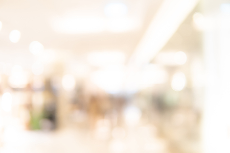 Foto de Abstract blur shopping mall corridor. Blurred retail and hall interior in department store. Defocused bokeh effect background or backdrop for business concept. - Imagen libre de derechos