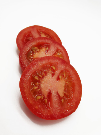 Tomatoes sliced ??on white background
