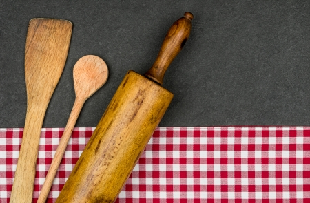 Rolling pin with wooden spoon on a slate plate