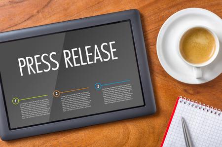 Foto de Tablet on a desk - Press Release - Imagen libre de derechos