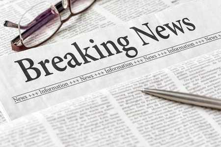A newspaper with the headline Breaking News