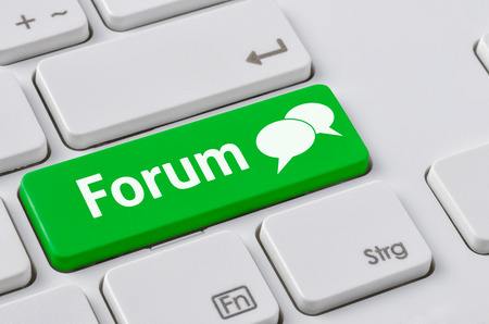 A keyboard with a green button - Forum