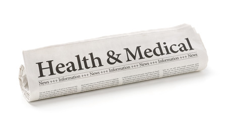 Foto de Rolled newspaper with the headline Health and Medical - Imagen libre de derechos