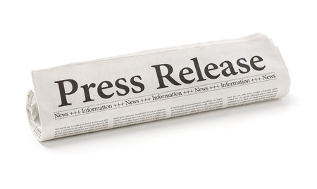 Foto de Rolled newspaper with the headline Press Release - Imagen libre de derechos