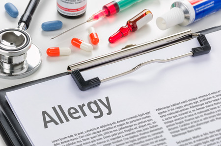 The diagnosis allergy written on a clipboard