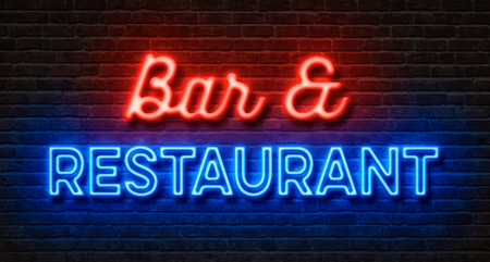 Foto de Neon sign on a brick wall - Bar and Restaurant - Imagen libre de derechos