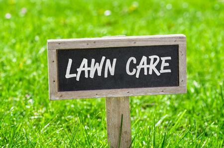 Foto de Sign on a green lawn - Lawn care - Imagen libre de derechos