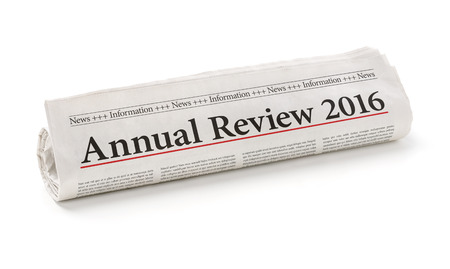 Photo for Rolled newspaper with the headline Annual review 2016 - Royalty Free Image