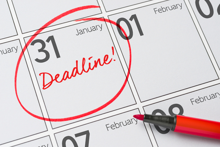 Foto de Deadline written on a calendar - January 31 - Imagen libre de derechos