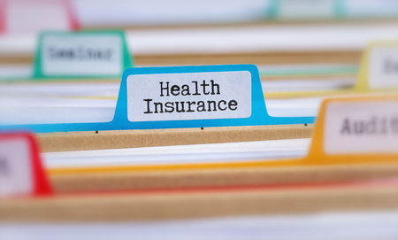 File folders with a tab labeled Health Insurance