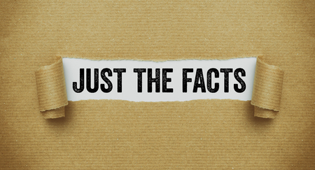 Foto de Torn brown paper revealing the words Just the facts - Imagen libre de derechos