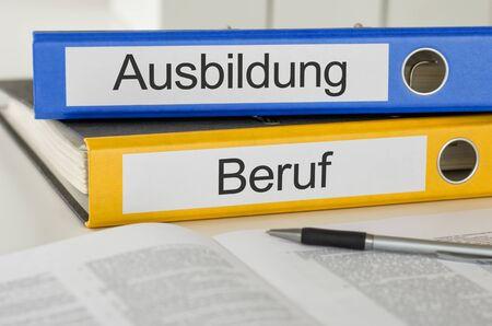 Photo pour Folders with the german label Ausbildung und Beruf - Training and Employment - image libre de droit