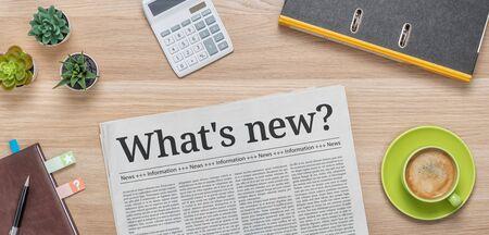 Photo pour A newspaper on a desk with the headline Whats new - image libre de droit