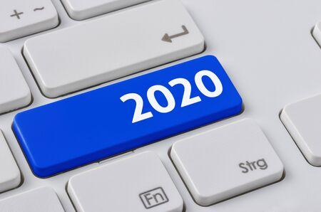 Foto de A keyboard with a blue button - 2020 - Imagen libre de derechos