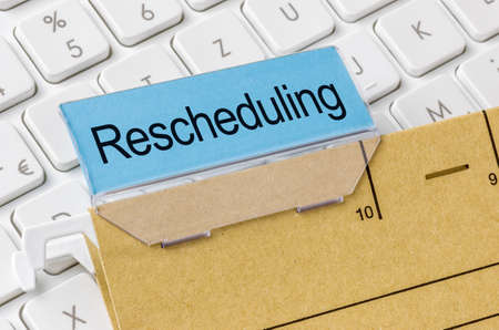 Photo pour A brown file folder labeled with Rescheduling - image libre de droit