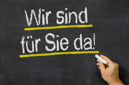Photo for We are there for you written on a blackboard in german - We are there for you - Royalty Free Image
