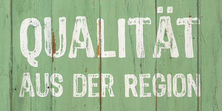 Photo for Wooden retro sign - Regional Quality in German - Quality from the region - Royalty Free Image