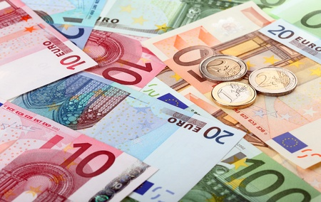 Different euro banknotes and coins