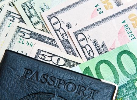Passport and money: dollars and euro