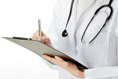 Doctor with stethoscope writing on a clipboard; closeup of doctor