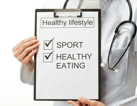 Closeup of doctor's hands holding clipboard with marked checkboxes which are basis of healthy lifestyle; healthy lifestyle concept; isolated on white background